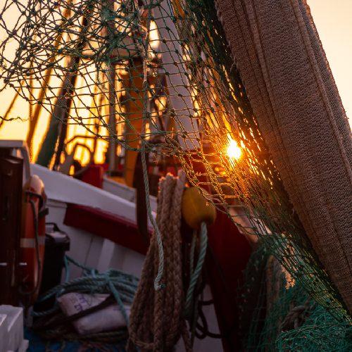 Nordseekerl-Home-Netz auf Boot im Sonnenuntergang